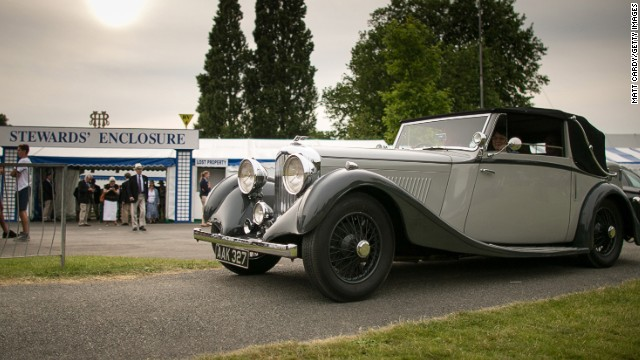 Here, visitors to the 2014 regatta leave in a 1930s Bentley car.