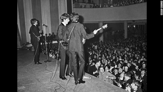 The Beatles perform on stage in Paris in 1964.