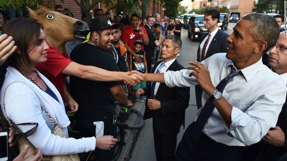 "U.S. President Barack Obama shakes hands with a man wearing a horse mask Tuesday, July 8, in downtown Denver. Obama <a href='http://www.cnn.com/2014/07/09/politics/obama-denver-night-out/index.html'>had an interesting night</a> in the city after he headlined a Democratic fundraiser earlier in the day. One man in a bar even offered marijuana to the President. As for the man in the horse mask, ""it's unclear what message he hoped to convey,"" wrote the pool reporter assigned to cover the visit."