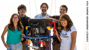 Teacher Fredi Lajvardi, with, from left, students Diserea Sanders, Sergio Corral , Martin Carranza, and Isela Martinez , and robot nicknamed \