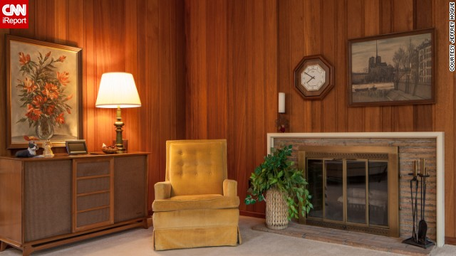 Everything about this room, from the chair, to the paneling, to the paintings, adds to the 1950s feel.
