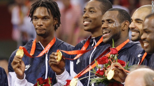 U.S. basketball players receive their gold medals after they defeated Spain at the 2008 Summer Olympics in Beijing. From left are Chris Bosh, Dwight Howard, James, Carlos Boozer and Michael Redd. James would also win a gold medal on the 2012 Olympic team.
