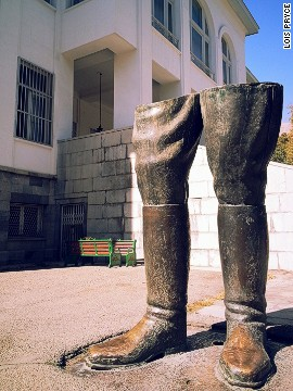 Outside the Shah's palace, only the legs remain of his colossal statue that was toppled during the 1979 Islamic Revolution.