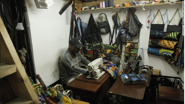 The business was founded by local entrepreneur Rizwan Janmohamed who wanted to offer souvenirs which were made from locally sourced materials to Zanzibar's many tourists. Craftsmen work busily in the back room of the shop, creating everything from iPad and phone covers to guitar cases and can holders in vibrant African prints.