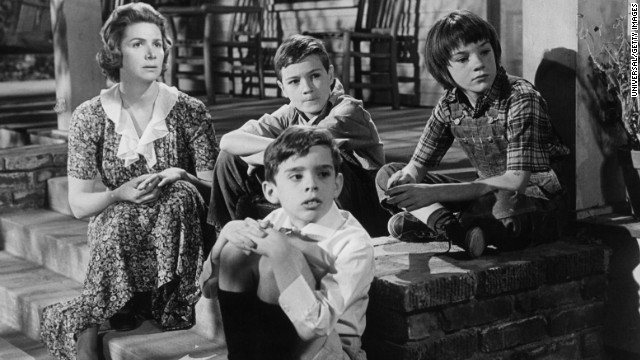 Rosemary Murphy, left, sits with Mary Badham, top right, and other children in a scene from the film