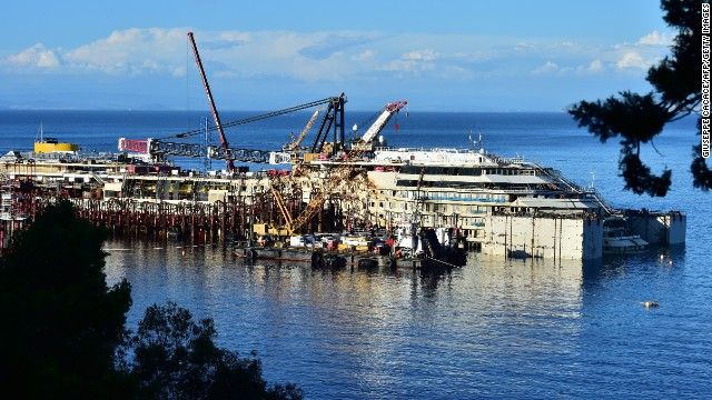 The wrecked Costa Concordia cruise ship lies off Giglio Island, Italy, on Friday, July 11. Efforts to refloat the vessel will begin on July 14, 2½ years after it foundered off the Tuscan island of Giglio. The Costa Concordia ran aground off Giglio in January 2012, killing 32 of the 4,200 people on board.