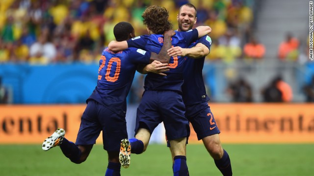 Daley Blind of the Netherlands, center, celebrates scoring his team's second goal with Georginio Wijnaldum, left, and Ron Vlaar.