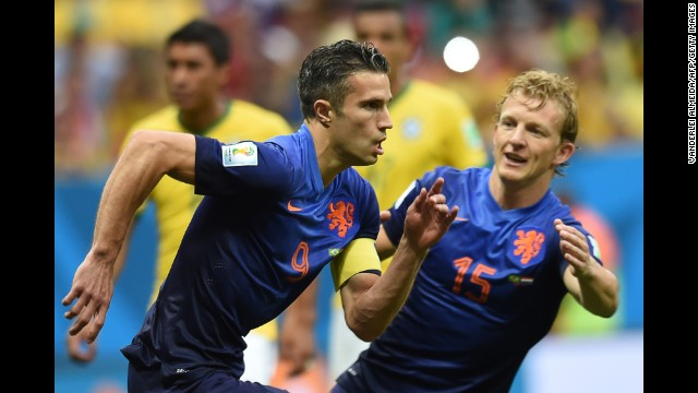 Netherlands forward and captain Robin van Persie, left, celebrates with Netherlands midfielder Dirk Kuyt after scoring a goal.