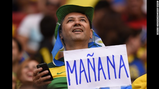 "An Argentine fan holds a sign reading ""tomorrow."""