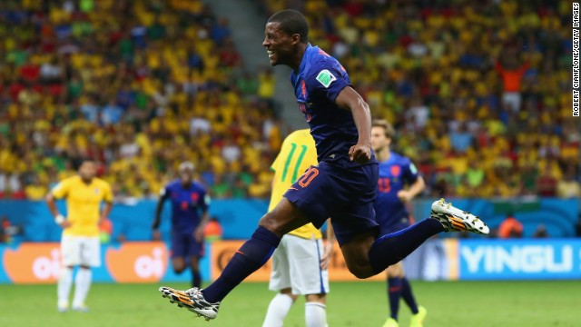 Georginio Wijnaldum of the Netherlands celebrates scoring his team's third goal during the third-place playoff match against Brazil on Saturday, July 12, in Brasilia, Brazil. The Netherlands defeated Brazil 3-0.