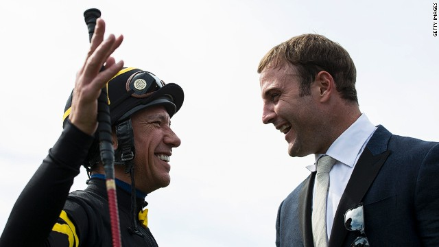 Denver Broncos star Wes Welker laughs alongside jockey Frankie Detorri at Newmarket.