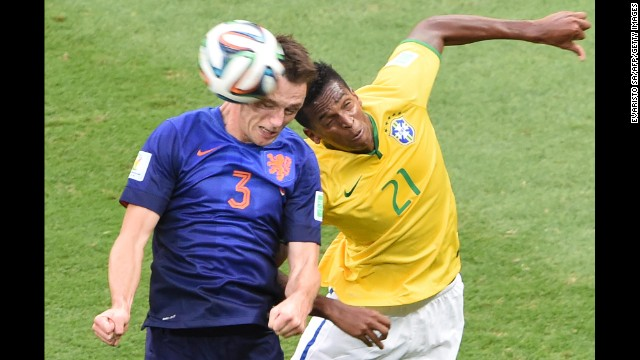 Netherlands defender Stefan de Vrij, left, and Brazil forward Jo vie for the ball.