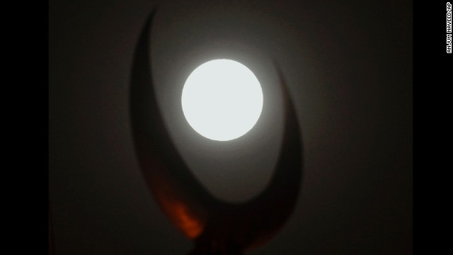 The moon is cradled in a crescent of the dome of the grand Faisal mosque in Islamabad, Pakistan.