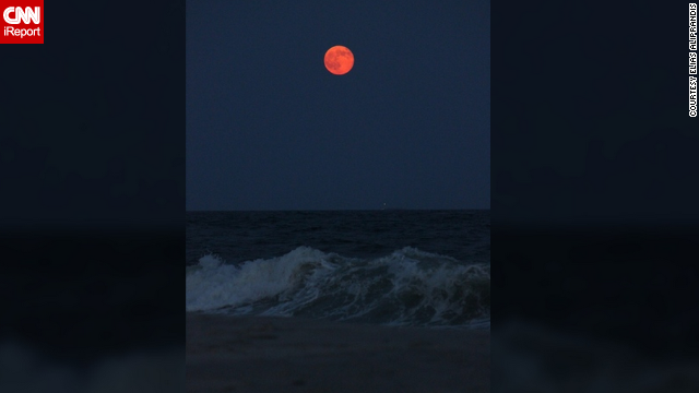 As the supermoon rose over the Long Island coast, <a href='http://ireport.cnn.com/docs/DOC-1152204'>Elias Aliprandis </a>said he was inspired to take a photo because of its amazing beauty and bright orange hue.