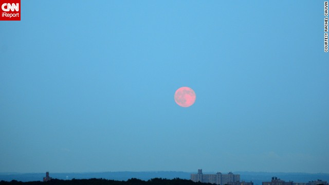 <a href='http://ireport.cnn.com/docs/DOC-1152253'>Rachel Cauvin</a> photographed the supermoon hanging over the Bronx, New York, sky. The morning haze seemed to give the moon a red hue.