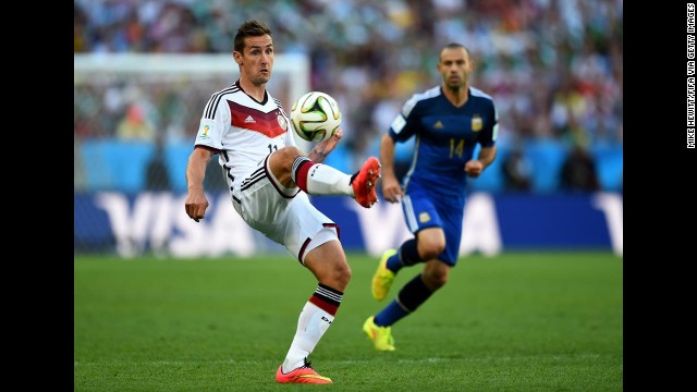 Klose controls the ball.