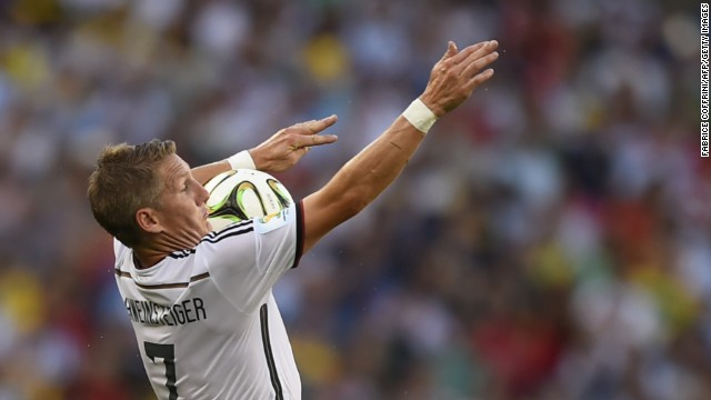 Schweinsteiger controls the ball on his chest.