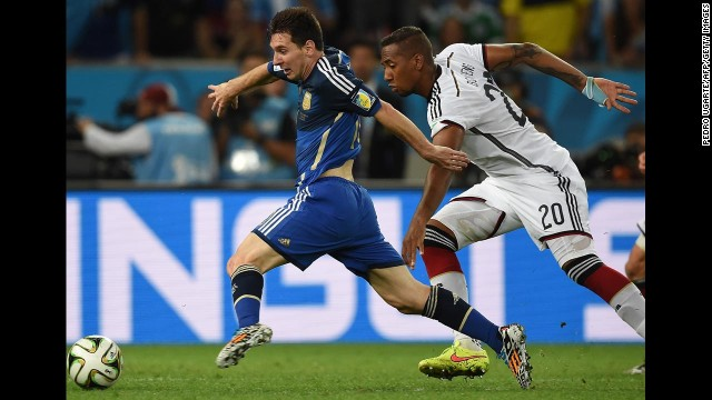 Messi, left, dribbles past German defender Jerome Boateng.