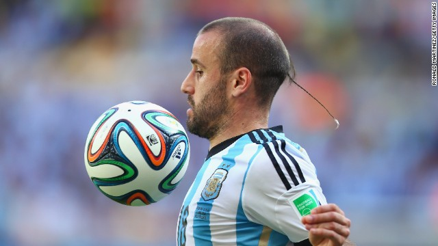 Argentina's Rodrigo Palacio sports a rat tail in the group stage of the 2014 tournament.