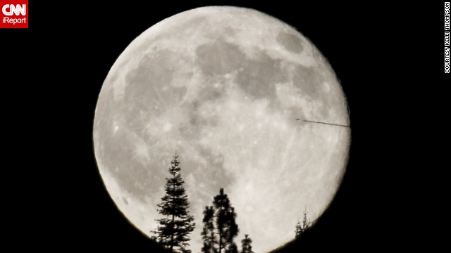 "<a href='http://ireport.cnn.com/docs/DOC-1152039'>Kelli Thompson</a> photographed the supermoon from the foothills of the Sierra Nevada Mountains in California. ""The airplane bisecting the supermoon was quite unusual and unexpected,"" she said."