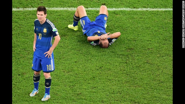 Argentina's Lionel Messi, left, and Pablo Zabaleta react after the match.