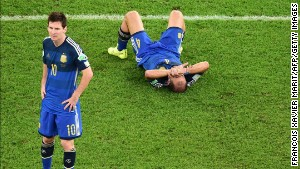 Argentina\'s Lionel Messi (L) and Pablo Zabaleta react after losing the 2014 FIFA World Cup final.