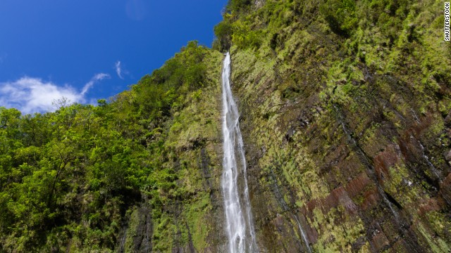 Off the famous Hana Highway, nestled into the Kipahulu District of Maui's Haleakala National Park, is the 400-foot Waimoku Falls.