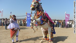 A decorated horse and his master participate in a competition in rural Dholera on Jaunary 8, 2012. About 40,000 people live in the area where the government hopes to build a new city.