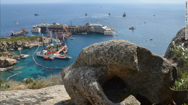 The Costa Concordia cruise ship, seen here on Monday, July 14, is set to be refloated this week, more than two years after it ran aground in Giglio, Italy. Thirty-two passengers and crew died in the wreck.