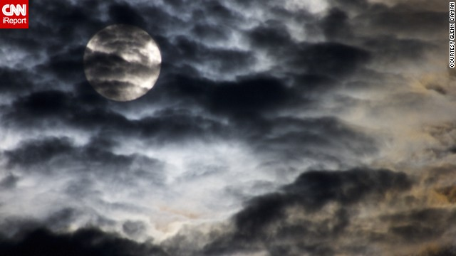 "Minister Glenn Daman shot this photo from his deck in Stevenson, Washington, as the moon<a href='http://ireport.cnn.com/docs/DOC-1152267'> rose on the mountains</a> across the Columbia River Gorge. He was hoping to capture ""the surreal and haunting image that the cloud covere provided."" We'd say he succeeded!"
