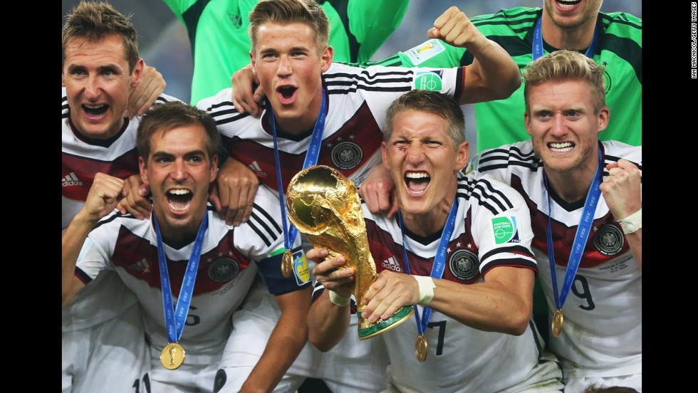 German players celebrate with the World Cup trophy after they defeated Argentina 1-0 in the tournament's <a href='http://www.cnn.com/2014/07/13/worldsport/gallery/world-cup-final-germany-argentina-2014/index.html'>final match</a> Sunday, July 13, in Rio de Janeiro. Mario Gotze's goal in extra time was the difference.