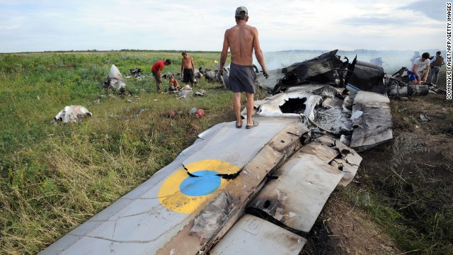 Villagers inspect wreckage of a Ukrainian transport plane Monday after it was shot down near the Russian border.