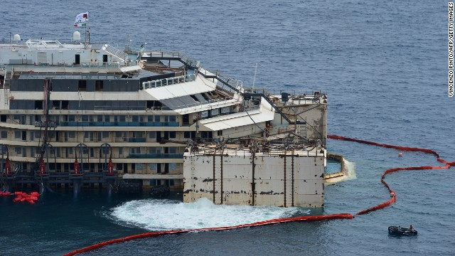 Water is expelled from the caissons hooked onto the Costa Concordia on Monday, July 14. The ship will be towed north to the port in Genoa, Italy.