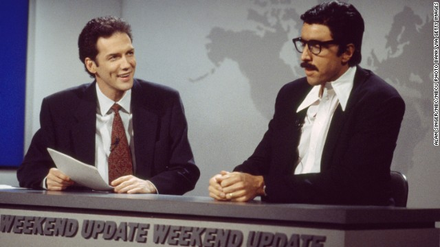 "Norm Macdonald, left, goofs around with Kevin Nealon on ""SNL."" Macdonald hosted Weekend Update from 1994 to 1997 but was ousted after NBC exec Don Ohlmeyer <a href='http://www.ew.com/ew/article/0,,274941_1,00.html' target='_blank'>complained that he wasn't funny. </a>"