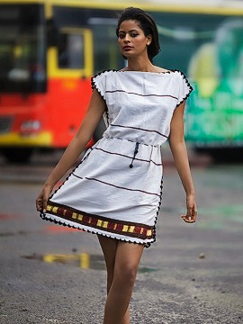 Elegant white dresses are often decorated with bold accents of color.