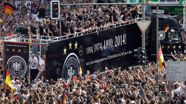 The streets of Berlin turn black, red and gold as thousands of fans welcome the squad.
