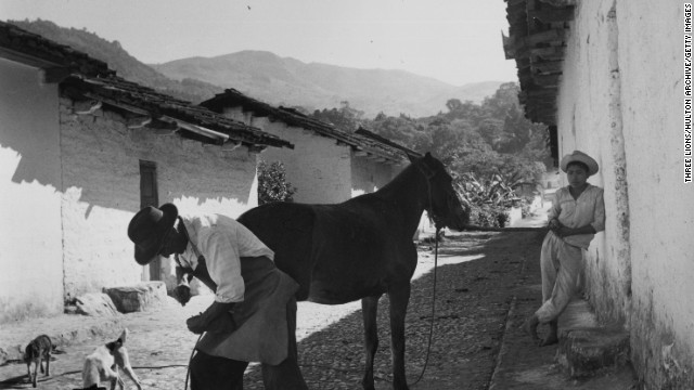 Farriery has been an occupation, and an art, for thousands of years, incorporating the skills of a blacksmith with elements of horsemanship. This photo shows a farrier at work in a Guatemalan mountain village in the 1950s.