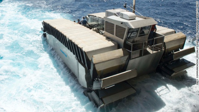 A half-scale Ultra Heavy-lift Amphibious Connector, also known as a UHAC, departs the amphibious dock landing ship USS Rushmore during the Rim of the Pacific exercise off Hawaii.