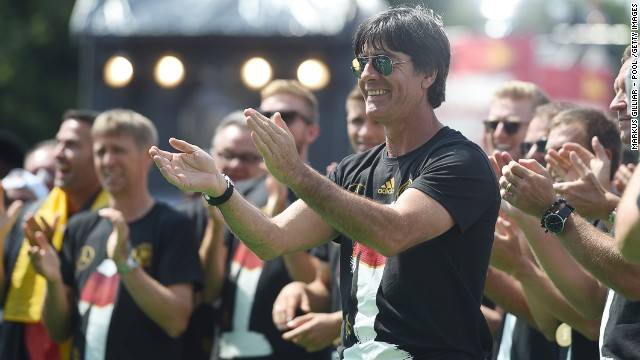 The team's coach Joachim Loew celebrates on stage.