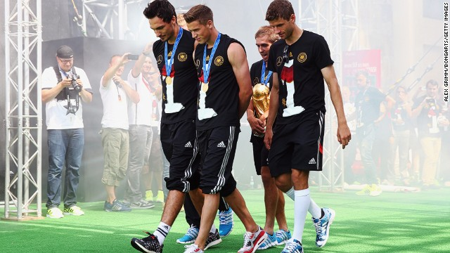 Mats Hummels, Erik Durm, Philipp Lahm and Thomas Mueller bring football's biggest prize onto the stage.