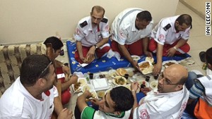 Ambulance crews take a break from their hectic day to break their fast during the Islamic holy month of Ramadan.