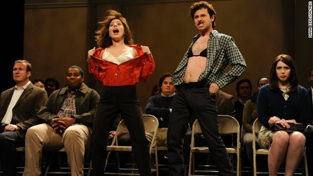 "<a href='http://www.deadline.com/2014/07/saturday-night-live-noel-wells-john-milhiser-leaving/' target='_blank'>According to Deadline,</a> John Milhiser (in the bra) has also been let go from ""SNL"" and will not be returning in the fall of 2014. His contract was reportedly not renewed after one season."
