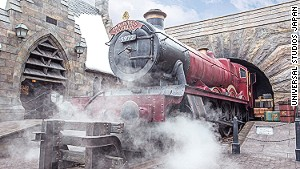 The famed scarlet Hogwarts Express steam engine is on display at Hogsmeade Station.