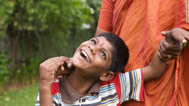 Nine-year-old Lakhan Kale smiles at his new home in Satara, where he lives and receives care with other deaf and mute children.