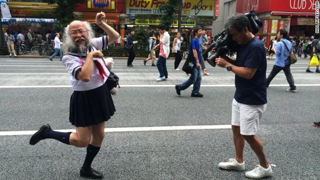 CNN photojournalist Hidetaka Sato records Kobayashi walking from Akihabara station to Waseda Juku -- a Tokyo cram school -- where he lectures students on the importance of being an individual.