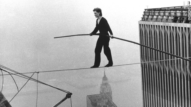 "French aerialist Philippe Petit dazzled onlookers below as he walked across a tightrope suspended between the World Trade Center's twin towers on August 7 in New York. Petit's long road to this feat was documented in James Marsh's 2008 documentary ""Man on a Wire."""