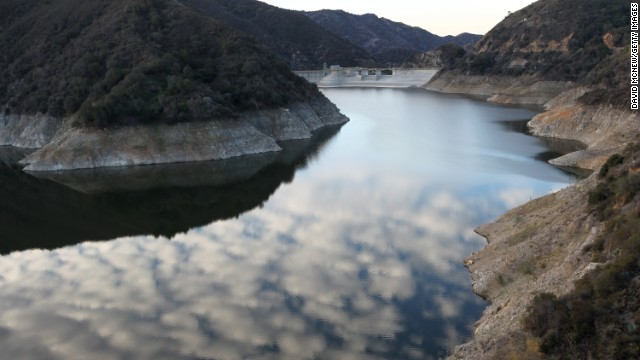 Rocky shores are exposed by the low waters of Morris Reservoir on the San Gabriel River near Azusa, California, on January 22.