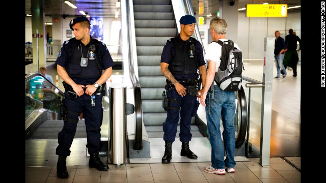 A man talks with security at Schiphol Airport on July 17.