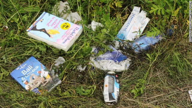Belongings of passengers lie in the grass on July 18.