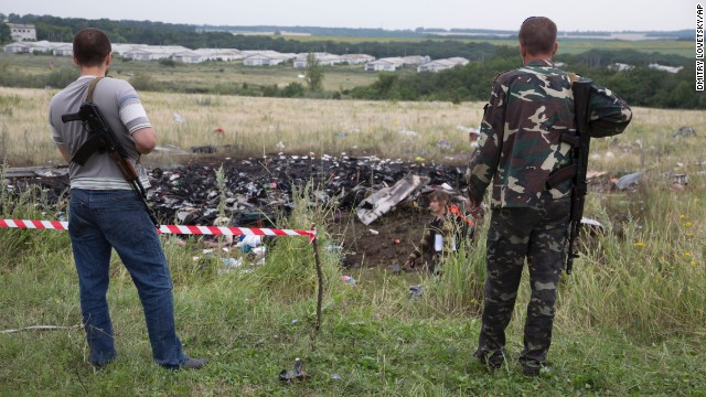 Pro-Russia rebels stand guard at the crash site.